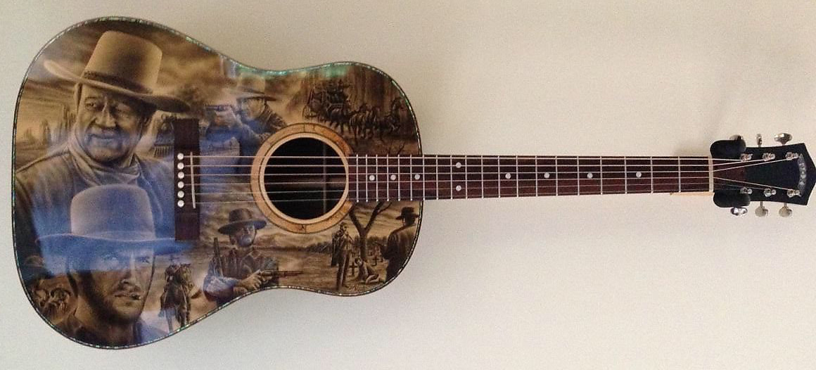 Cowboy guitars, painted guitars with Western themes