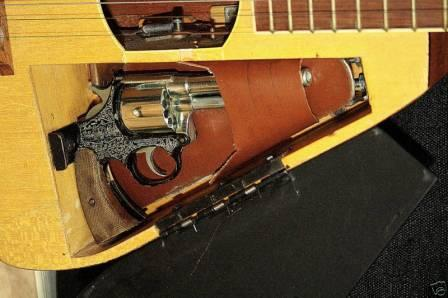 Guitar from Italy with hidden gun compartment